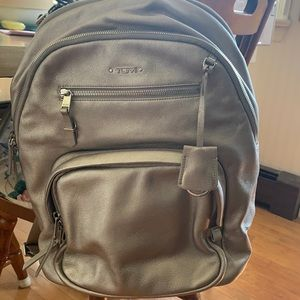 Metallic Tumi backpack